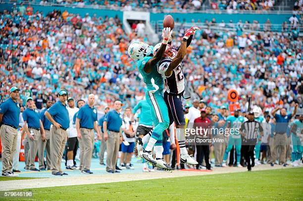 Miami Dolphins Wide Receiver DeVante Parker leaps in the air to juggle the ball and then finally make the reception as New England Patriots...