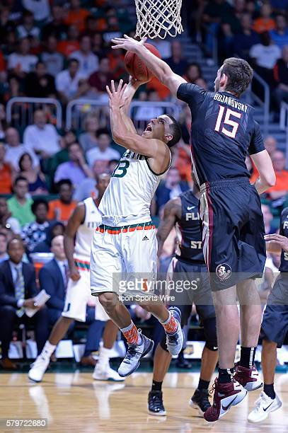 Miami guard Angel Rodriguez attempts to put up a basket over Florida State center Boris Bojanovsky in the second half as the University of Miami...