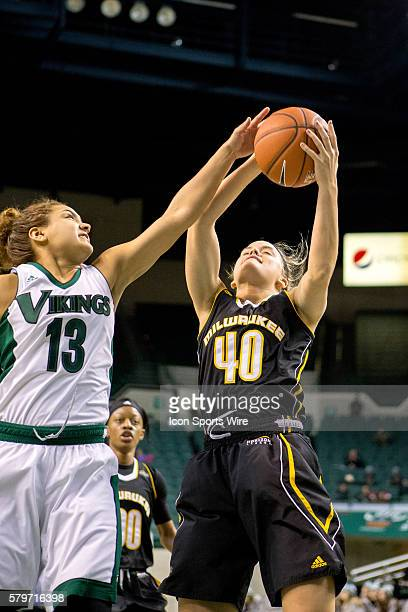 Milwaukee Panthers F Emma Dau pulls down a rebound against Cleveland State Vikings Guard Mariana Bautista during the third quarter of the NCAA...