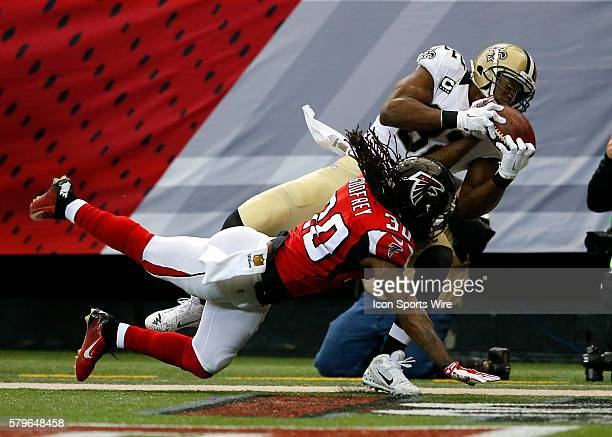 New Orleans Saints tight end Benjamin Watson dives for a touchdown catch over Atlanta Falcons free safety Charles Godfrey in first half action of the...