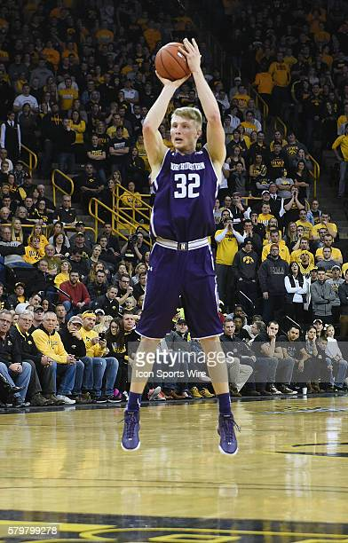 Northwestern forward Nathan Taphorn hits a three point shot in the first half during a Big Ten Conference mens basketball game between the...