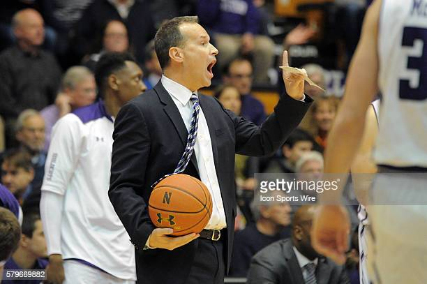 Northwestern Wildcats head coach Chris Collins holds the game ball as he talks to players during a game between the Ohio State Buckeyes and...