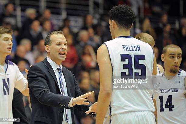 Northwestern Wildcats head coach Chris Collins talks with Northwestern Wildcats forward Aaron Falzon during a game between the Ohio State Buckeyes...