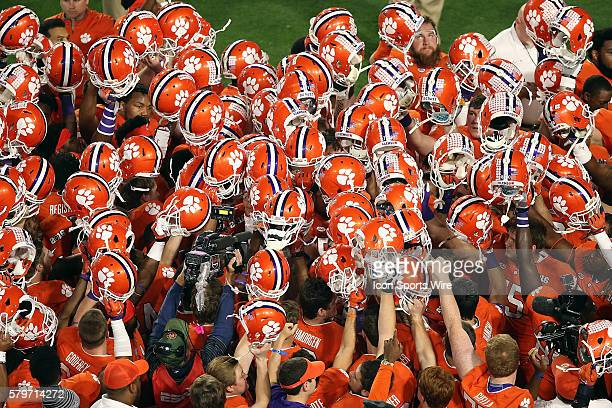 The Clemson Tigers huddle before the start of the College Football Playoff National Championship game against the Alabama Crimson Tide at University...