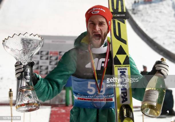 Nordic skiing / ski jumping World Cup Four Hills Tournament Großschanze Men Final Second placed Markus Eisenbichler from Germany cheers with his...