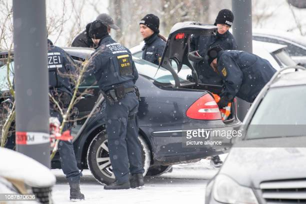 24 January 2019 BadenWuerttemberg Stuttgart Police officers search a car of trial visitors on the day the verdict is expected in the trial of alleged...