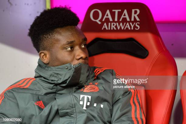 Soccer Bundesliga Bayern Munich VfB Stuttgart 19th matchday in the Allianz Arena Alphonso Davies of FC Bayern Munich sits on the bench before the...