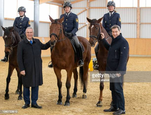 Markus Söder Minister President from Bavaria and Joachim Herrmann Minister of the Interior from Bavaria are standing beside the police riders Lisa...