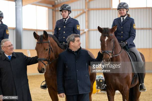 Markus Söder Minister President from Bavaria and Joachim Herrmann Minister of the Interior from Bavaria are standing next to the police riders Robin...