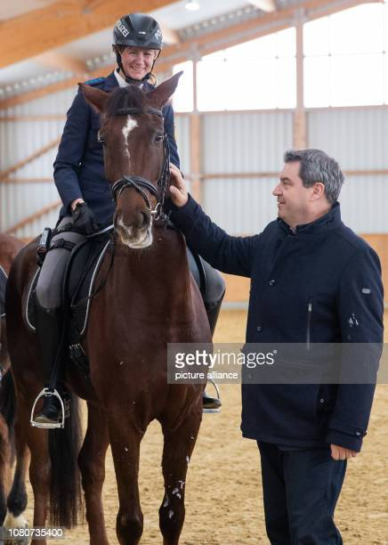 Markus Söder Prime Minister of Bavaria stands next to police rider Stephanie Sendker with horse Noris The first four animals of the new riding group...