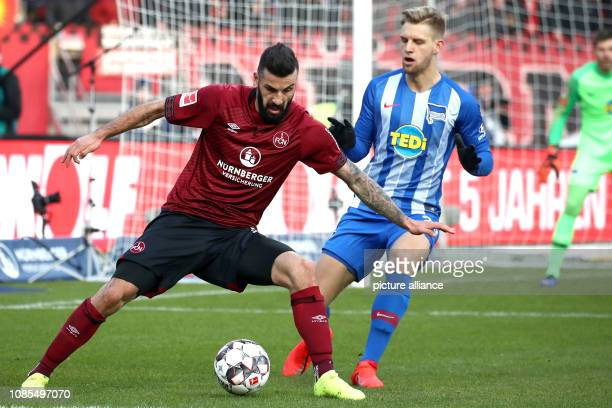 Soccer Bundesliga 1st FC Nuremberg Hertha BSC 18th matchday in Max Morlock Stadium Mikael Ishak from Nuremberg fights with Arne Maier from Berlin for...
