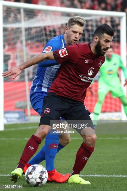 Soccer Bundesliga 1st FC Nuremberg Hertha BSC 18th matchday in Max Morlock Stadium Mikael Ishak from Nuremberg fights with Arne Maier from Berlin for...