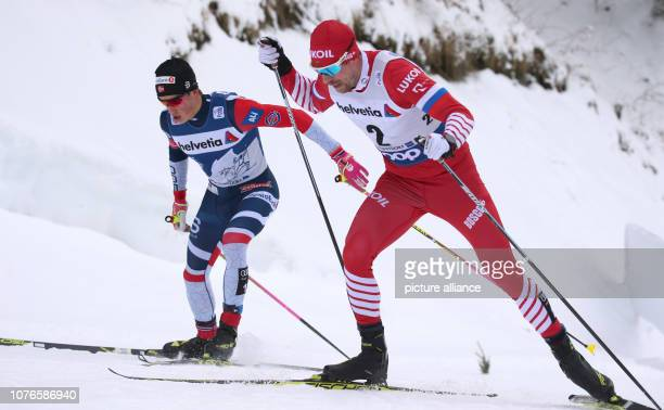 Nordic skiing / crosscountry skiing World Cup Tour de Ski 15 km classic pursuit men Johannes Hoesflot Klaebo from Norway and Sergej Ustjugow from...