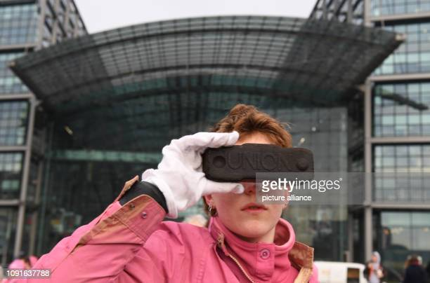 January 2019, Berlin: A demonstrator shows a performance during a campaign of the environmental protection organisation Greenpeace. The reason for...