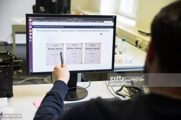 January 2019, Berlin: A lexicographer at the Berlin-Brandenburg Academy of Sciences and Humanities points to a computer screen. The Centre for...
