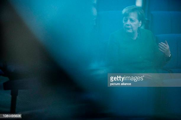 Chancellor Angela Merkel sits in the plenary hall of the German Bundestag The main topics of the 74th session of the 19th legislative period are the...