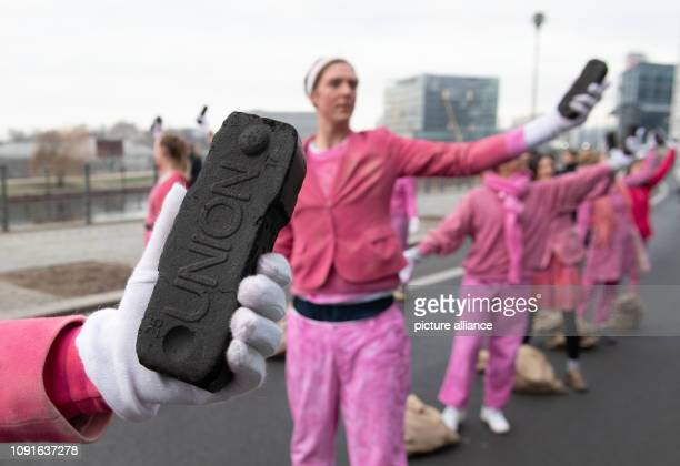 Demonstrators show a performance in an action of the environmental protection organization Greenpeace The reason for the action is the presentation...