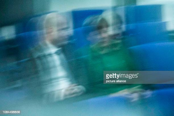 Federal Chancellor Angela Merkel and Ralph Brinkhaus Chairman of the CDU/CSU parliamentary group in the Bundestag are talking in plenary session in...
