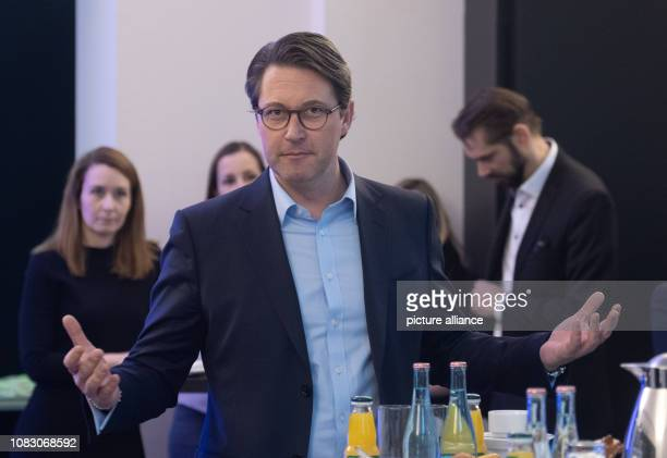 Federal Transport Minister Andreas Scheuer speaks to journalists at a press breakfast Previously Scheuer had met with head of railways Lutz and...