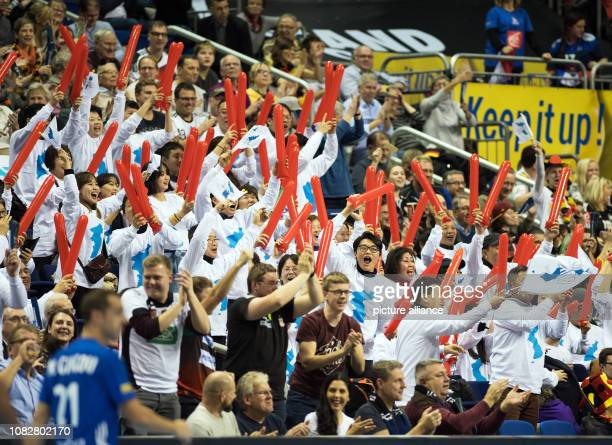 Handball WM France Korea preliminary round group A 3rd matchday Spectators in white shirts cheer a goal from the Korean team Photo Soeren Stache/dpa