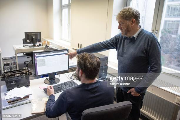 January 2019, Berlin: Linguist Wolfgang Klein looks over the shoulder of lexicographer Sebastian Göttel at the Berlin-Brandenburg Academy of Sciences...