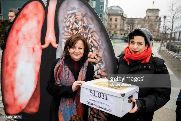 Marlene Mortler federal drugs commissioner receives a petition from Anne Isakowitsch campaign leader at SumOfUs for a tobacco outdoor advertising ban...
