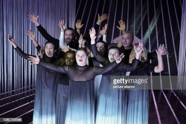Performers stand on the stage of the Deutsches Theater during the photo rehearsal of the play 'Antigone' The play is a coproduction with the...