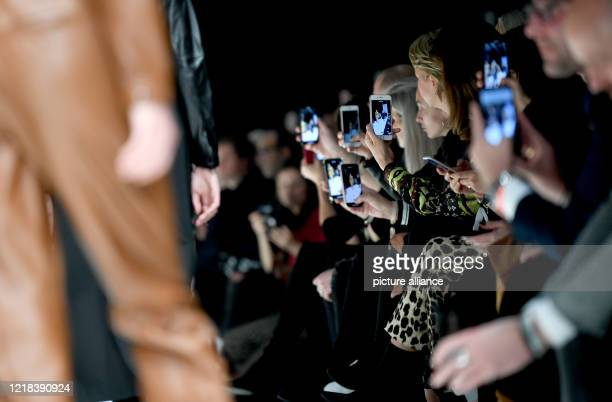 """January 2019, Berlin: The audience is filming the collections for Autumn/Winter 2019/2020 at the fashion show of the label """"Riani"""" at E-Werk during..."""