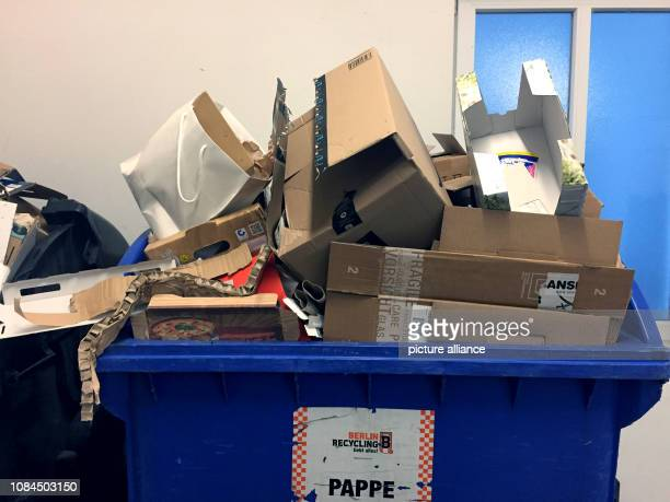 Waste paper barrels full to bursting with paper cardboard and cardboard are placed in a garbage room Photo Alexandra Schuler/dpa