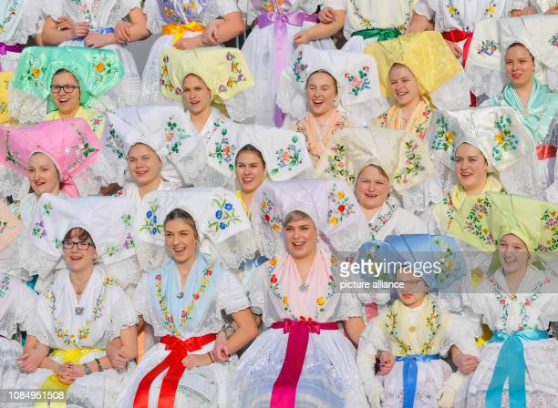 Young women and girls in original SorbianWendish festive costumes have set themselves up for a group photo at the traditional Zapust the youth...