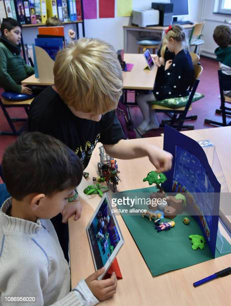 January 2019, Brandenburg, Potsdam: In class 3d of the Rosa-Luxemburg-Grundschule pupils create different Stop Motion with tablets on the subject of...