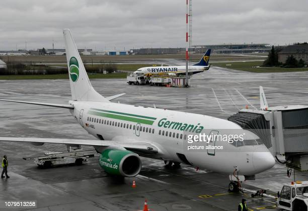 Germania flight ST 3612 to Beirut is handled at Schoenefeld Airport while a Ryanair aircraft rolls to take off in the background After the turbulent...