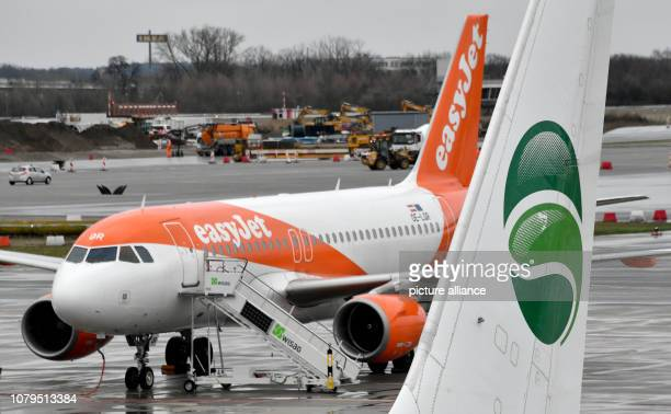 The logo of the airline Germania can be seen at Schoenefeld Airport on the tail of an aircraft in front of an Easyjet aircraft After the turbulent...
