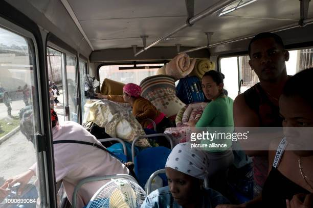 Cubans board a bus in Luyano which after a tornado has caused devastation is supposed to take them to an emergency shelter A violent tornado on Cuba...