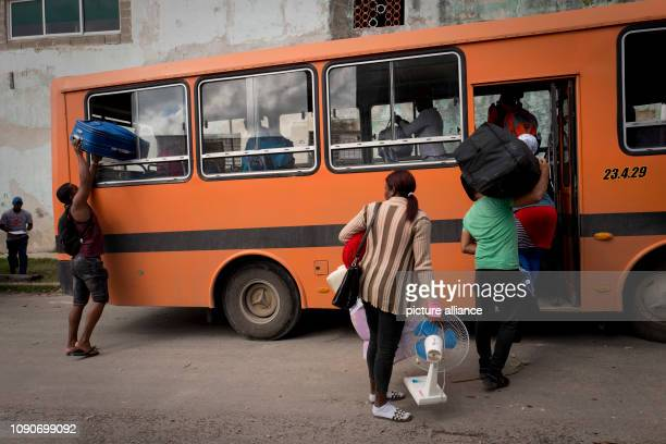 Cubans board a bus in the district of Luyano which after a tornado has wreaked havoc is supposed to take them to an emergency shelter A violent...