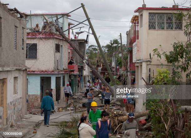 Cubans clean up Luyano after a tornado wreaked havoc A violent tornado on Cuba on Sunday evening cost at least three people their lives Another 172...