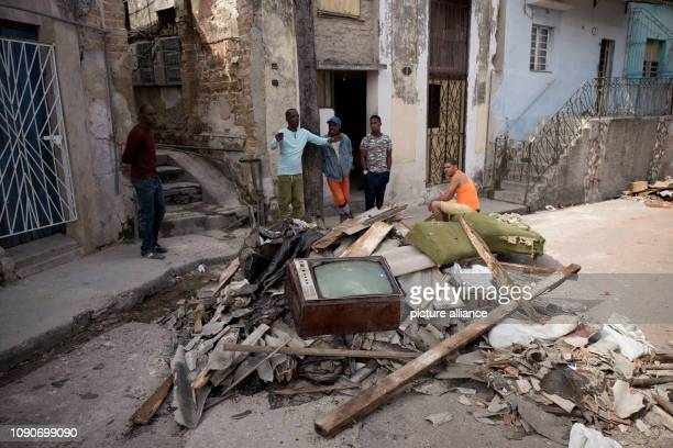 Cubans clean up Luyano County after a tornado wreaked havoc A violent tornado on Cuba on Sunday evening cost at least three people their lives...