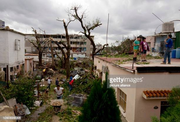 Cubans clean up Regla County after a tornado wreaked havoc A violent tornado on Cuba on Sunday evening cost at least three people their lives Another...