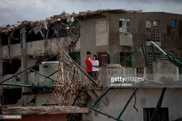 Cubans embrace in Regla County after a tornado wreaked havoc A violent tornado on Cuba on Sunday evening cost at least three people their lives...