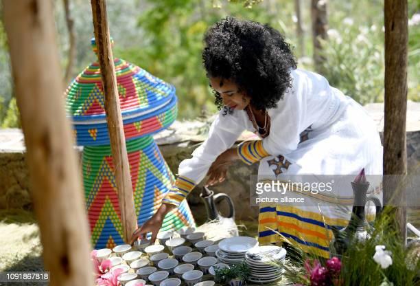 January 2019, Ethiopia, Lalibela: A woman prepares a traditional coffee ceremony. Photo: Britta Pedersen/dpa-Zentralbild/ZB