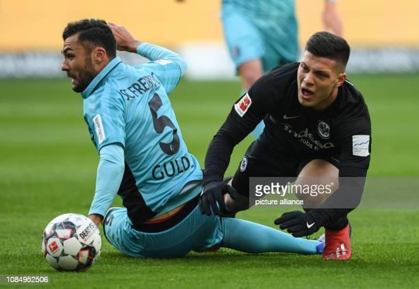 Soccer Bundesliga Eintracht Frankfurt SC Freiburg 18th matchday in the Commerzbank Arena Frankfurt's Luka Jovic and Freiburg's Manuel Gulde fight for...