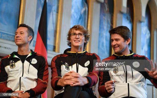 The two tennis players Philipp Kohlschreiber and Alexander Zverev as well as team captain Michael Kohlmann participate in the draw of the Davis Cup...