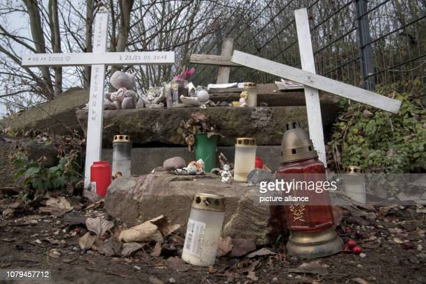 Wooden crosses grave lights and figures of angels made of plaster remind of the dead Susanna at an improvised memorial Photo Boris Roessler/dpa