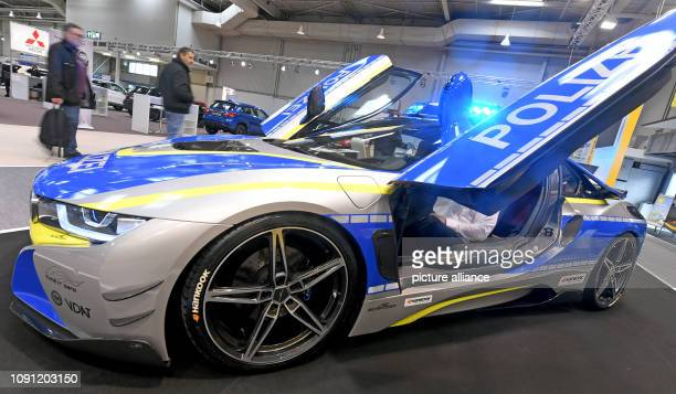 A BMW stuck with police foil and pimped up attracts the attention of the visitors at the leisure fair abf The car is intended to draw attention to...