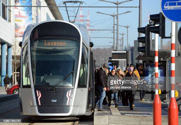 January 2019, Luxembourg, Luxemburg: People get off the tram in the Kirchberg banking district in Luxembourg. From 1 March 2020, bus and train...