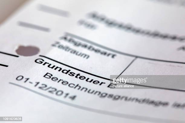 30 January 2019 MecklenburgWestern Pomerania Schwerin Illustration A tax assessment for the payment of the property tax lies on a desk...