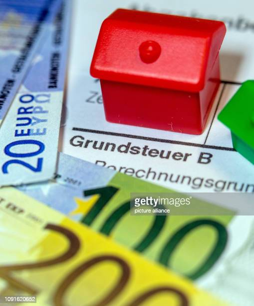 30 January 2019 MecklenburgWestern Pomerania Schwerin Illustration A toy store and the replica of euro banknotes are on a tax bill for the payment of...
