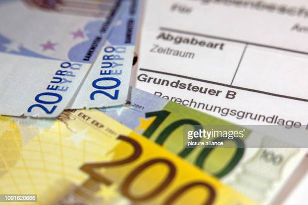 30 January 2019 MecklenburgWestern Pomerania Schwerin Illustration The replicas of euro banknotes are on a tax bill for the payment of property tax...