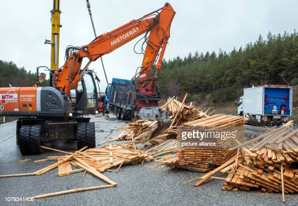 08 January 2019 MecklenburgWestern Pomerania Stolpe Employees of salvage companies clear the wood load lost in a truck accident from the A24...
