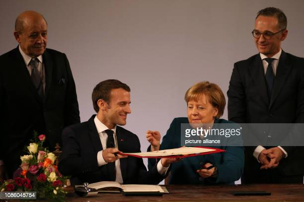 22 January 2019 North RhineWestphalia Aachen Emmanuel Macron President of France and German Chancellor Angela Merkel sign the treaty observed by...